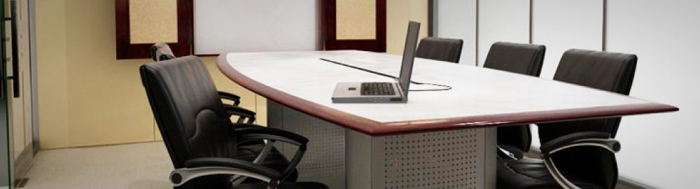 Photo of a chair at a desk facing a laptop